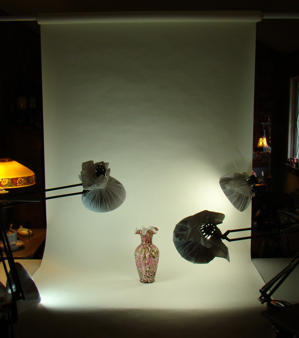 Photo studio with paper backdrop and lamps