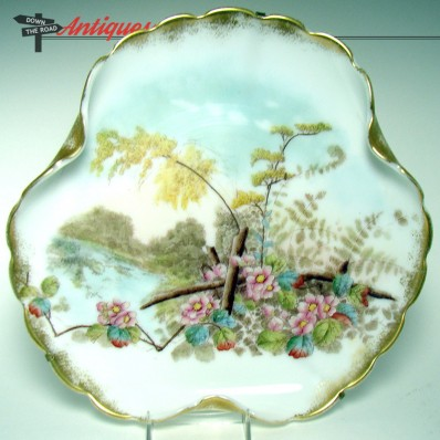 Hand-painted Mount Washington glass wall plaque with floral river scene