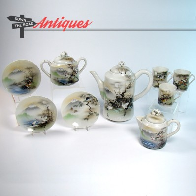Hand-painted Japanese porcelain tea set with creamer and six cups
