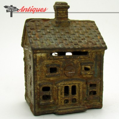 Antique cast iron still bank in the shape of a Colonial house