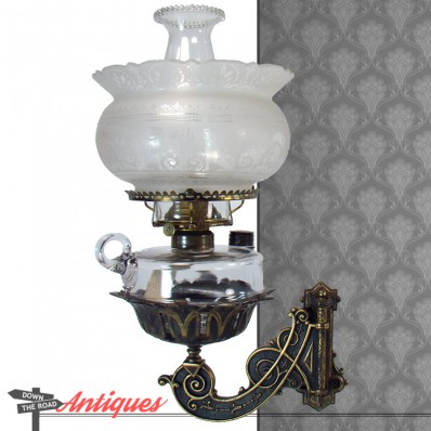 Victorian cast iron bracket lamp with winged griffin shade