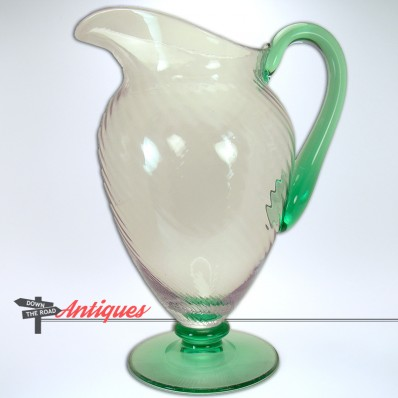 Steuben spiral-ribbed Pomona glass water pitcher with applied green handle