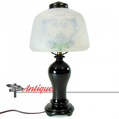 Reverse-painted electric boudoir lamp with hand-painted floral shade and black glass base