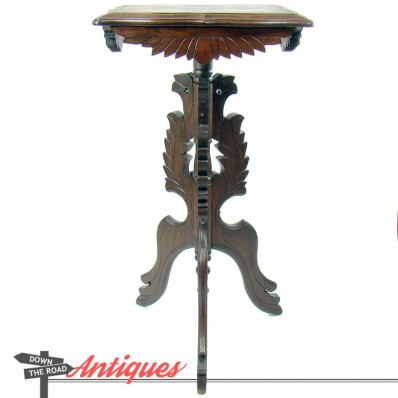Fancy hand-carved Victorian walnut fern stand with incised top and flared legs