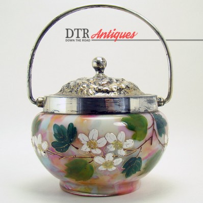 Enameled end-of-the-day art glass condiment holder with hand-painted floral design and silver plated repousse lid