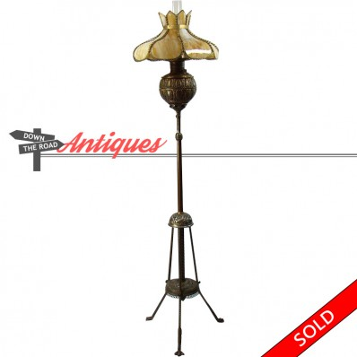 Victorian pull-down piano lamp with caramel slag shade and iron base