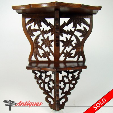 Hand-carved Chinese rosewood curio shelf with folding leaves and bamboo design