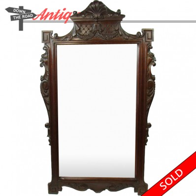 Solid hand-carved walnut mirror with lion heads and shell design, 1890's