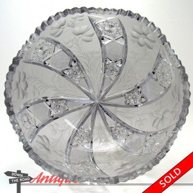 Signed Tuthill cut glass bowl with floral and pinwheel design