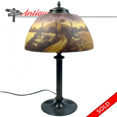 Phoenix reverse-painted electric table lamp with embossed base and scenic shade