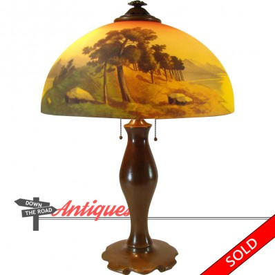 Phoenix electric table lamp with reverse painted scenic shade depicting trees and mountain, c. 1920's