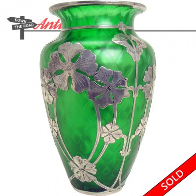 Diamond quilted green glass vase with sterling silver overlay, circa 1920's