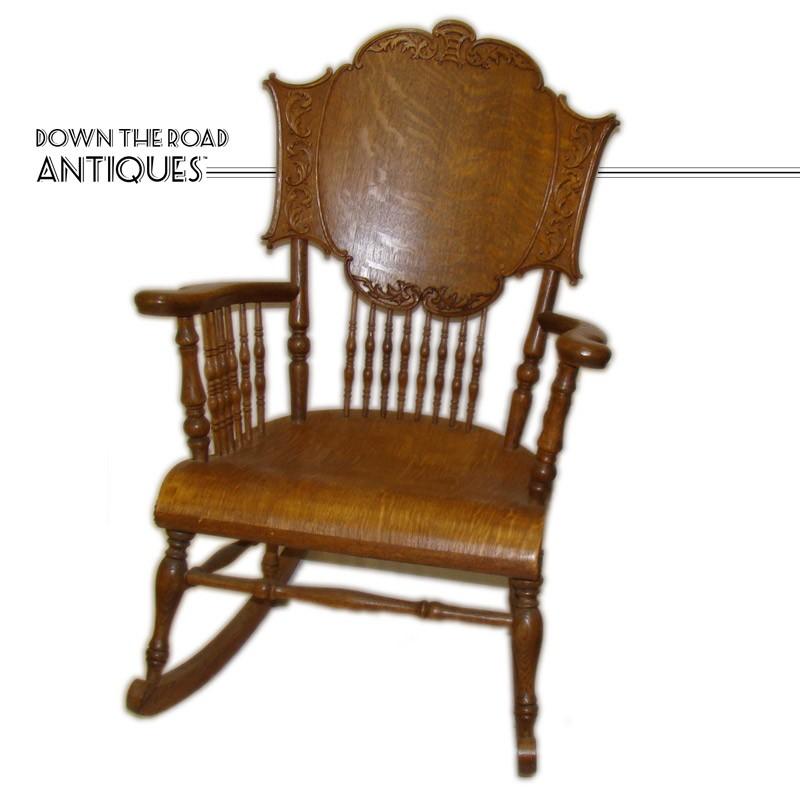 Carved quarter-sawn oak rocking chair with spindles from the early 1900's - Carved Quartersawn Oak Rocking Chair With Spindles DTR Antiques