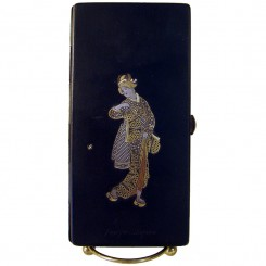 I believe this piece dates from the early 1900's. It's a beautiful Japanese  cigarette holder and is inlaid with 24k gold, sterling and copper.   The workmanship on this piece is truly fantastic. I believe it is all inlaid on brass and probably Neillo bac