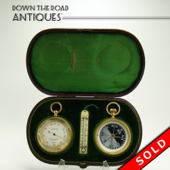 Bausch and Son barometer, altimeter, compass and thermometer in fitted case with green silk and velvet lining