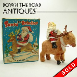 Santa Claus and reindeer Christmas wind-up toy, mint in the original box