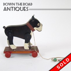 Vintage Boston Terrier pull-toy with moving legs by Hustler Toys c. 1920