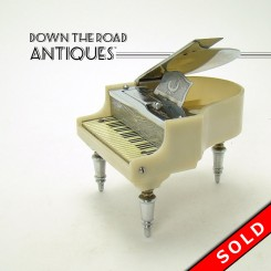 White grand piano table lighter made in Occupied Japan, press keys to light