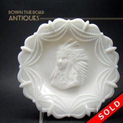 Opalescent white glass plate with embossed Native American head