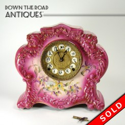 Porcelain Mantle Clock with Embossed Lions