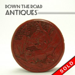 Carved Chinese cinnabar box with figures and decorations