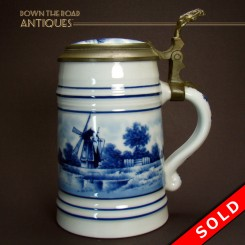 Holland Delft porcelain beer stein with hand-painted windmill and ocean scene, lithophane and pewter mounts