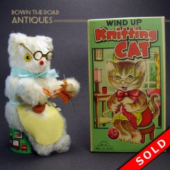 Mechanical knitting cat in rocking chair wind-up toy with the original box
