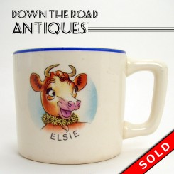 Borden's Elsie the Cow ceramic mug with handle and blue rim