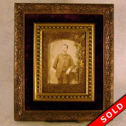 Ornate picture frame with photo of man and velvet-lined interior from the 1880's