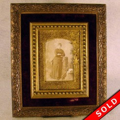 Victorian ornate picture frame with photo of a woman and a velvet-lined frame from the 1880's