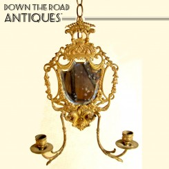 Gilt bronze beveled mirror and wall-hanging candelabra with floral motif, c. 1850's
