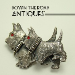 Scotty Dog Brooch with Marcasite Collars and Ruby Glass Eyes