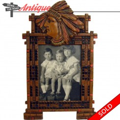 Cold-painted cast iron picture frame with Native American in headdress, by Bradley and Hubbard