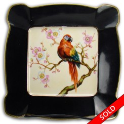 Hand-painted porcelain Noritake charger with parrot, thick black border and gold details