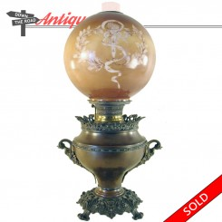Bradley and Hubbard banquet lamp with original globe and figural handles, circa 1880's