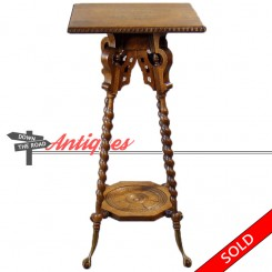 Carved oak table with rope-twist legs and brass claw feet from the 1890's