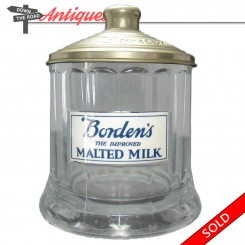 Borden's Malted Milk container with milk glass label and metal lid