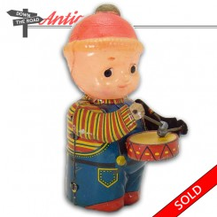 Pre-war tin and celluloid drummer boy wind-up toy in near-mint condition