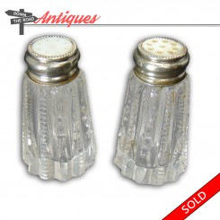 Cut glass and silver plated salt and pepper shakers with inlaid mother of pearl caps