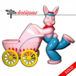 Hard plastic candy container with bunny rabbit pushing baby carriage