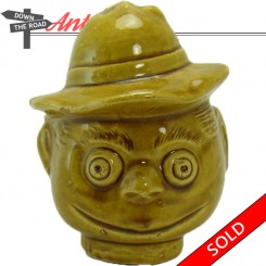 Brown glazed ceramic pottery head bank with smiling man in hat