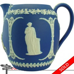 Blue and white Wedgwood Jasperware water pitcher with Roman figures