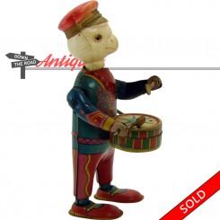 Patriotic tin and celluloid bird drummer wind-up toy, pre-war