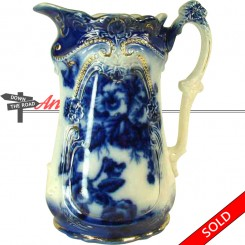 Flow Blue porcelain water pitcher with gold details and floral design