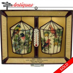 Advertising thermometer with plastic birds in cages from Amos Bawell butchering, sheering and Duroc breeding