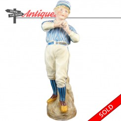 Heubach bisque baseball player statue with blue and white striped shirt