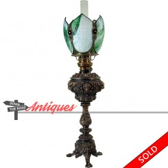 Bradley and Hubbard banquet lamp with slag glass and ruby faceted jewels with figural heads
