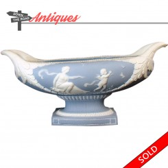 Large blue and white Jasperware centerpiece planter with depiction of woman and child chasing butterflies