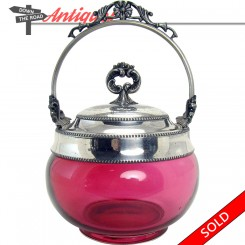 Victorian cranberry glass condiment container with silver plated holder and lid