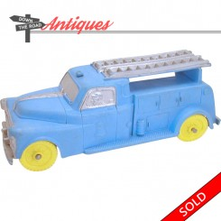 Blue Auburn Rubber telephone truck toy with yellow tires, Made in U.S.A.
